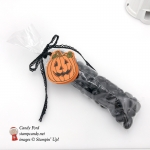 Candy filled 2x6 cellophane bag makes an ideal Halloween Treat. It has been topped with Stampin