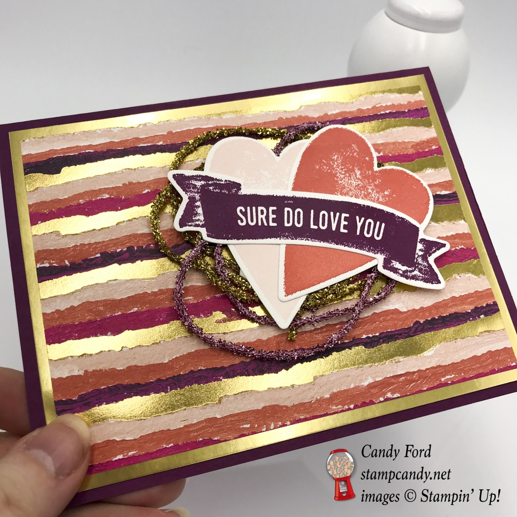 Here's a shiny gold and pink Valentine card made with the Sure Do Love You stamp set, Lots to Love Box Framelits Dies, Painted with Love Designer Series Paper DSP, Love Mini Tinsel Trim Combo Pack, by Stampin' Up! #stampcandy